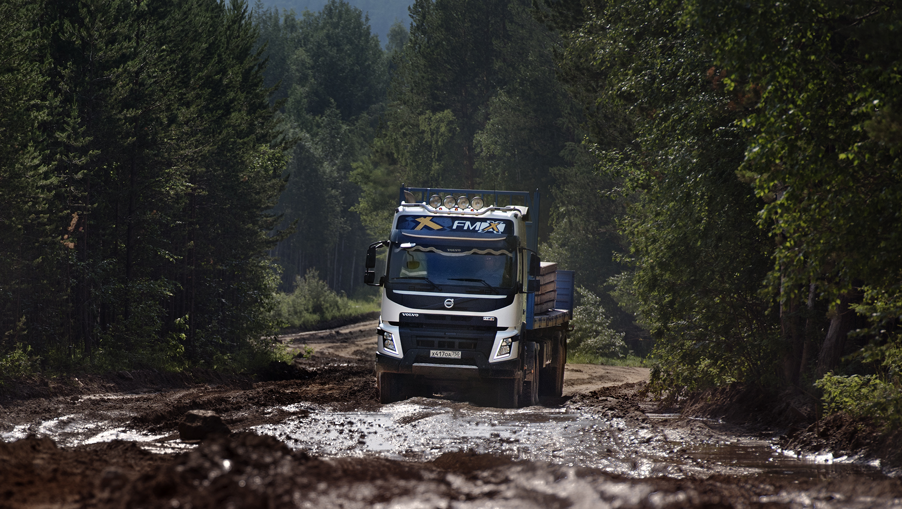 Volvo FMX driving through mud